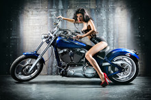 Wall Mural - Young sexy woman sitting on motorcycle.
