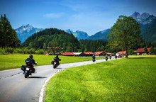 Wall Mural - Motorcyclists on mountainous road
